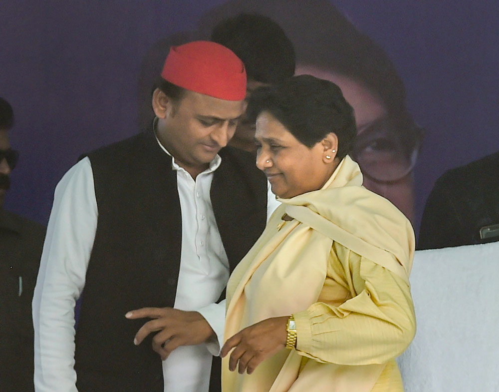 The perception that the Samajwadi Party's Akhilesh Yadav (left) and the Bahujan Samaj Party's Mayawati are leaders of specific caste groups instead of being representative in a truly democratic sense may have undermined the electoral fortunes of the Opposition in UP