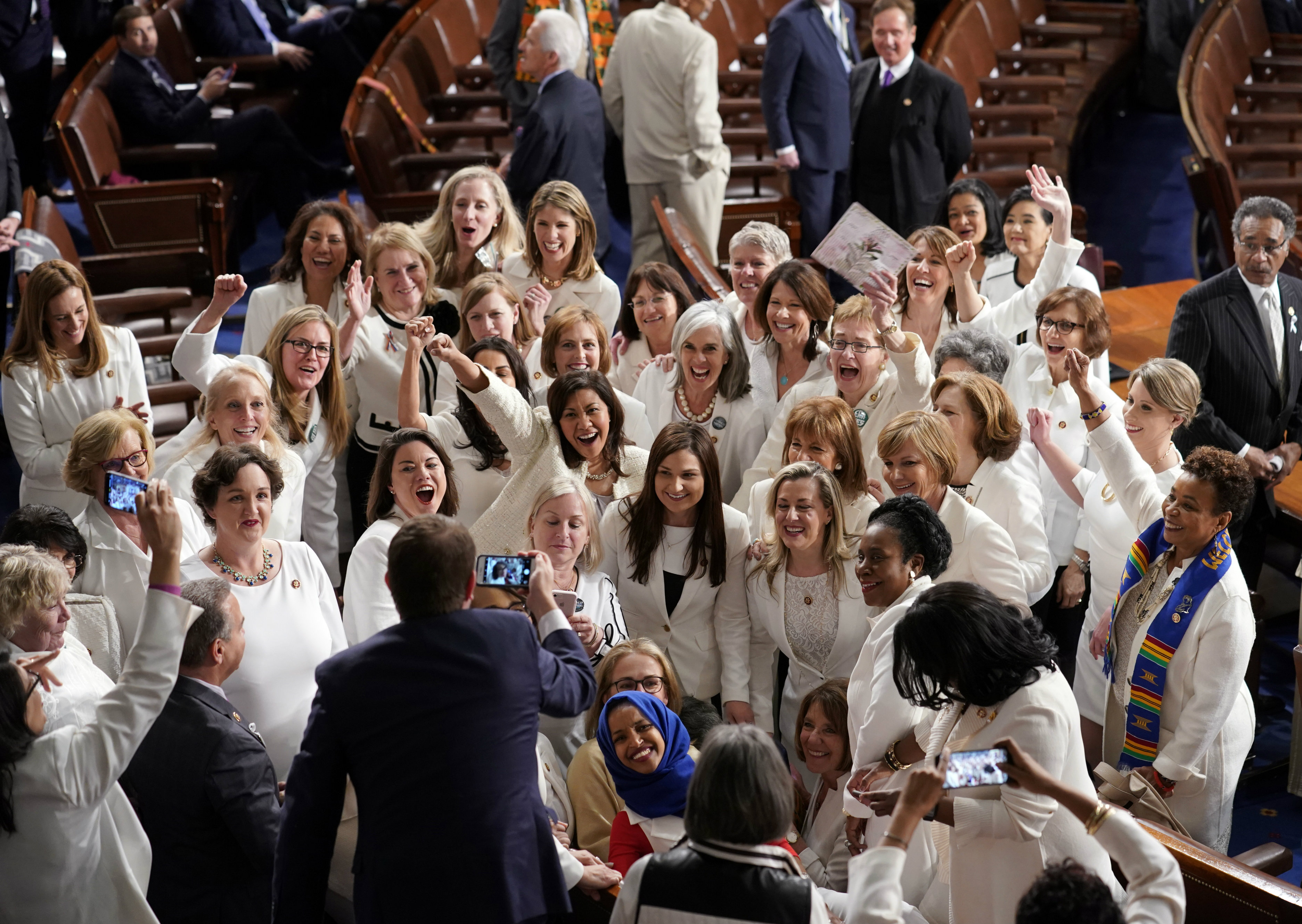 As Congress awaited Donald Trump's entrance, the most striking sight was the unmistakable block of Congresswomen practically aglow in white on the Democratic side of the aisle.