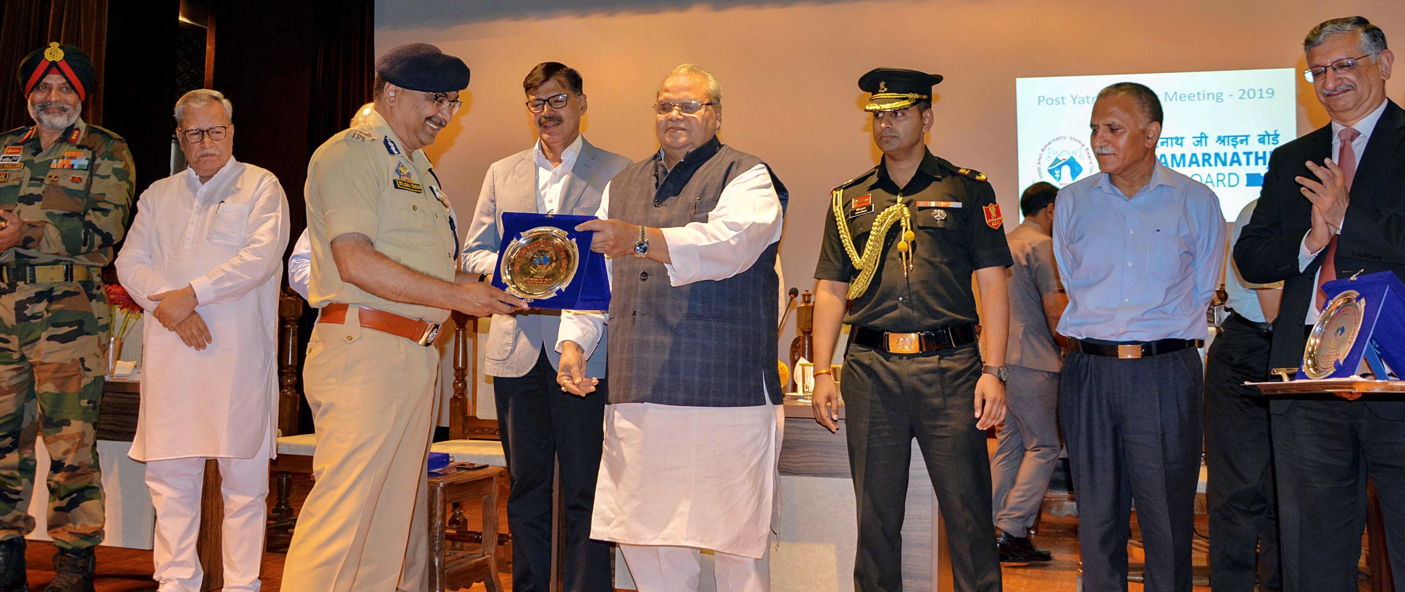Jammu and Kashmir governor Satya Pal Malik felicitates state police chief Dilbagh Singh for conducting successful Amarnath Yatra at Raj Bhavan on August 28.