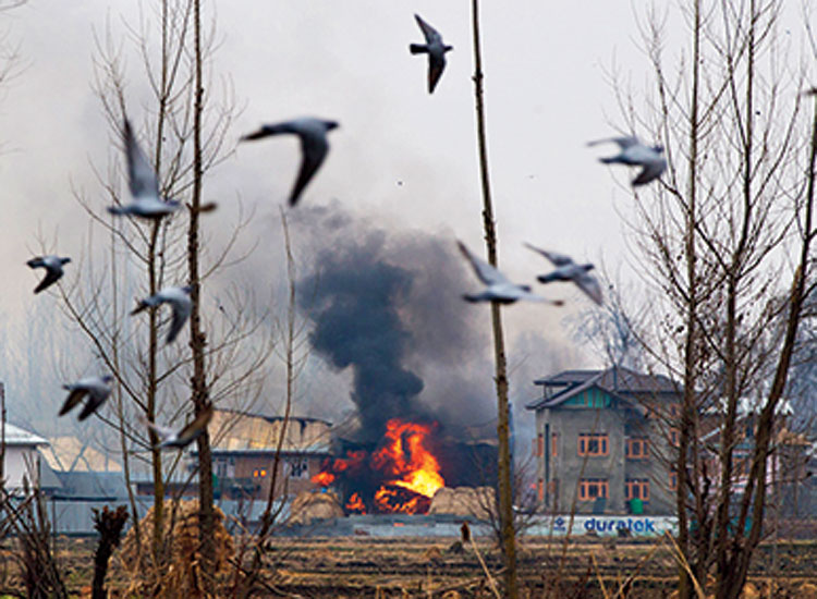 Flames billow from a house where militants were suspected to have taken refuge during a gun battle in Pulwama on February 18, 2019. The Pulwama attack was absolutely detestable.... But, to use the air-strike on a terror training camp as political fodder is to demean political discourse.