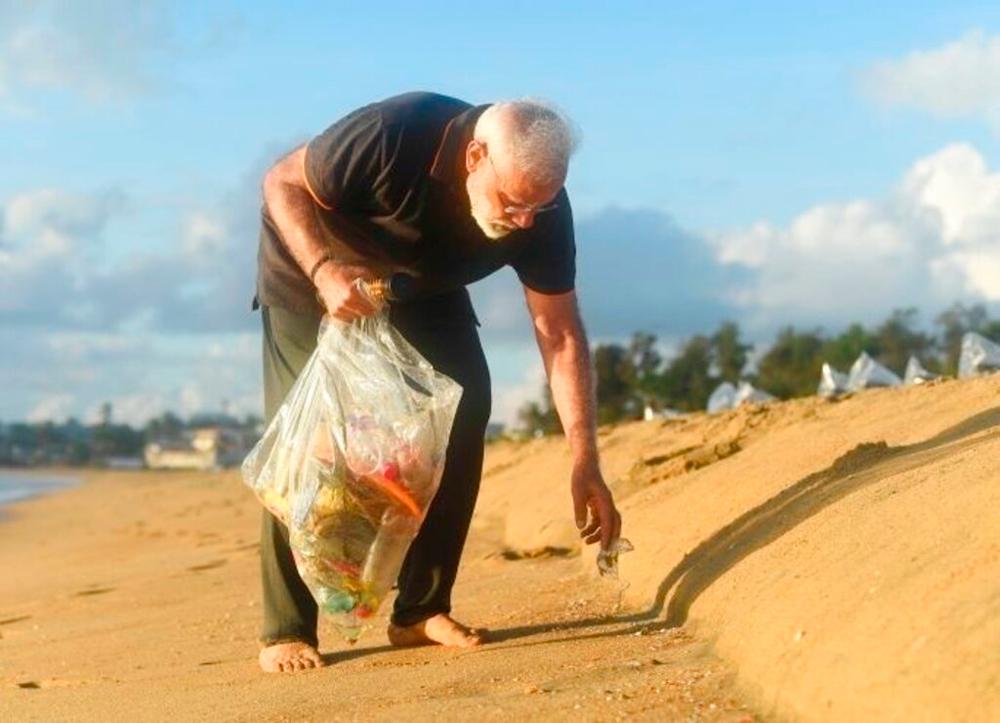 Prime Minister Narendra Modi picks trash from a beach in Mamallapuram, Tamil Nadu, on October 12