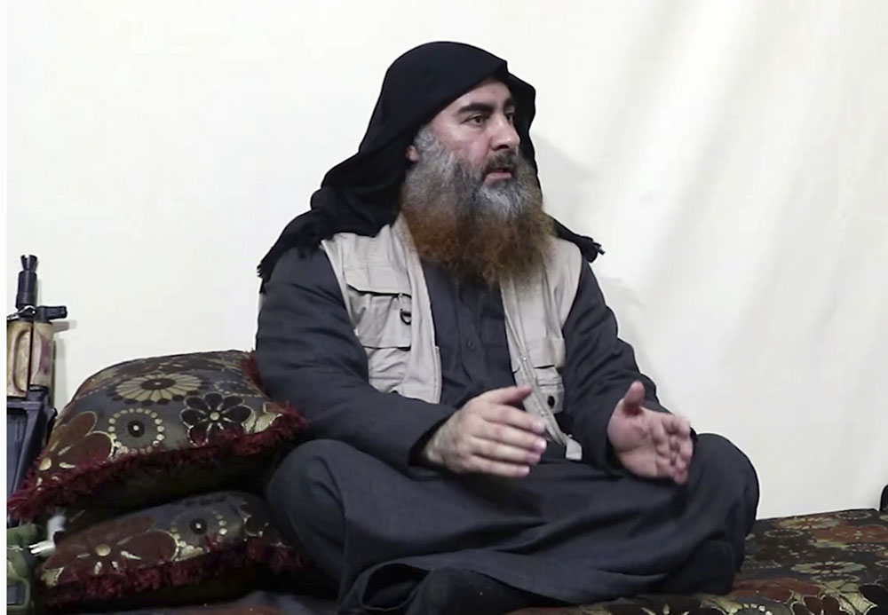 Leader of the Islamic State group, Abu Bakr al-Baghdadi, being interviewed by his group's Al-Furqan media outlet