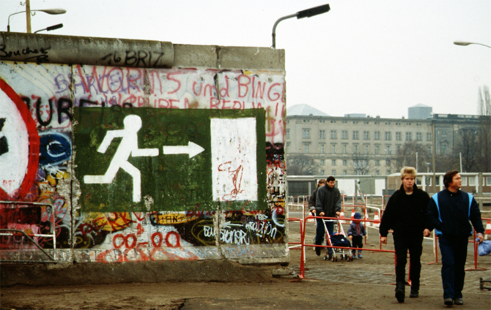 People walk freely after the fall of the Berlin Wall, 1989.