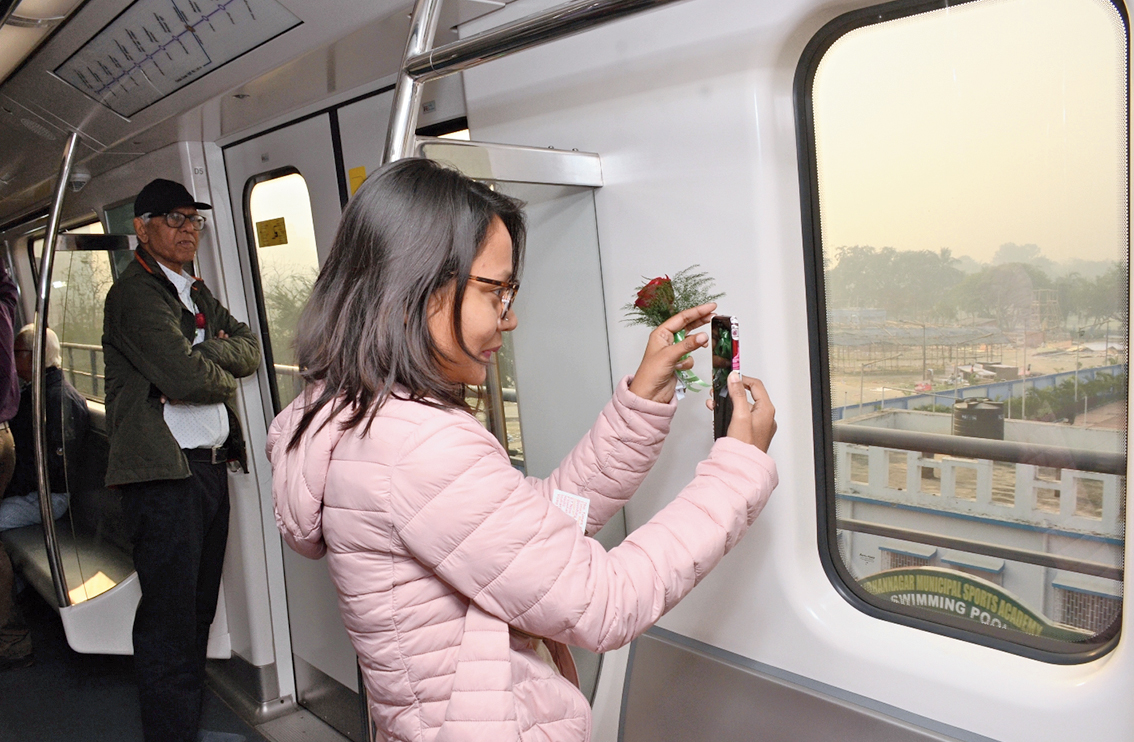 Somwrita Guha of EE Block clicks Central Park from inside the train as her father Tapas Guha watches.