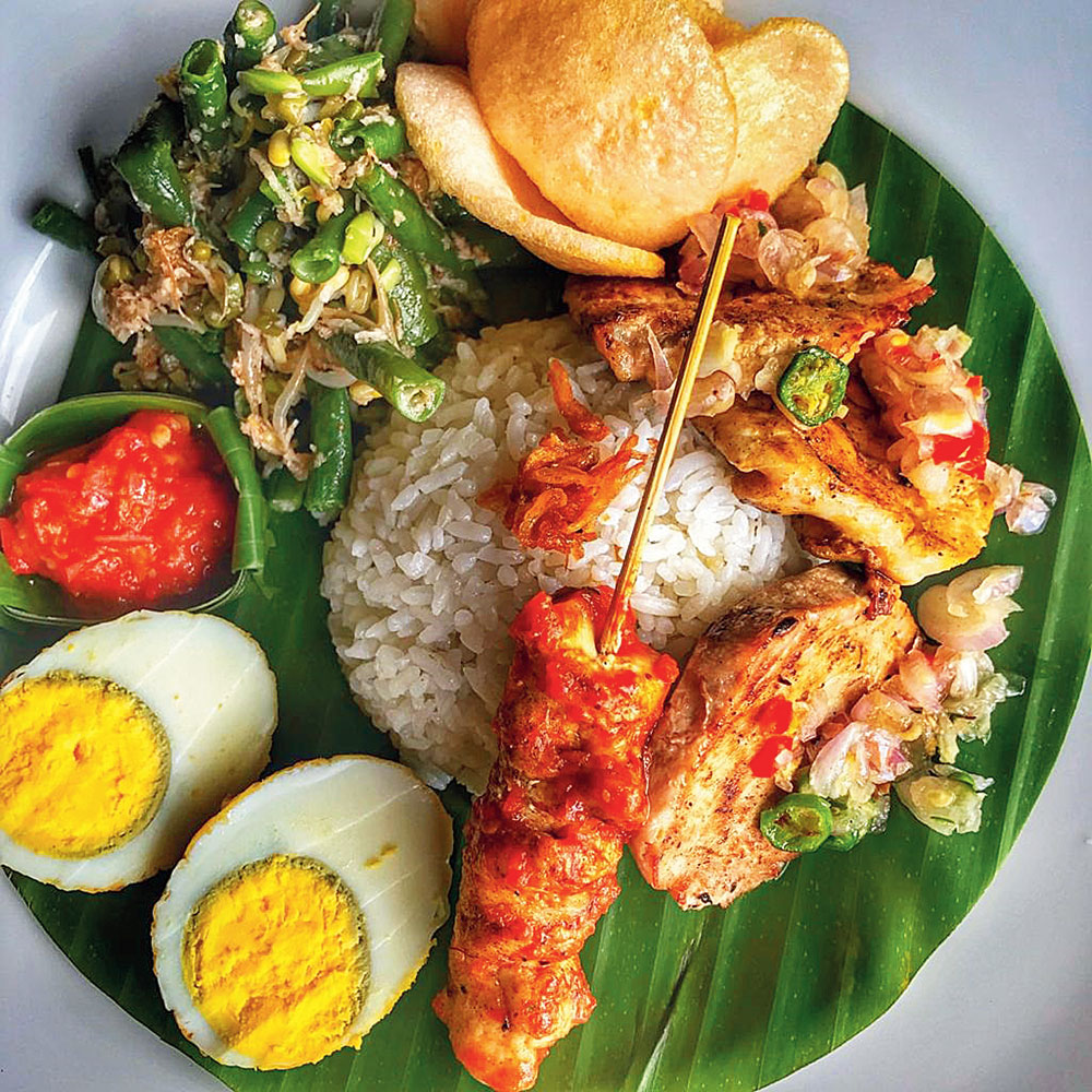 Indulge in nasi ayam (chicken and rice) and, particularly, nasi campur