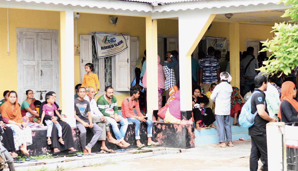 People wait outside an NRC hearing centre at Bakaliaghat in Karbi Anglong on Tuesday