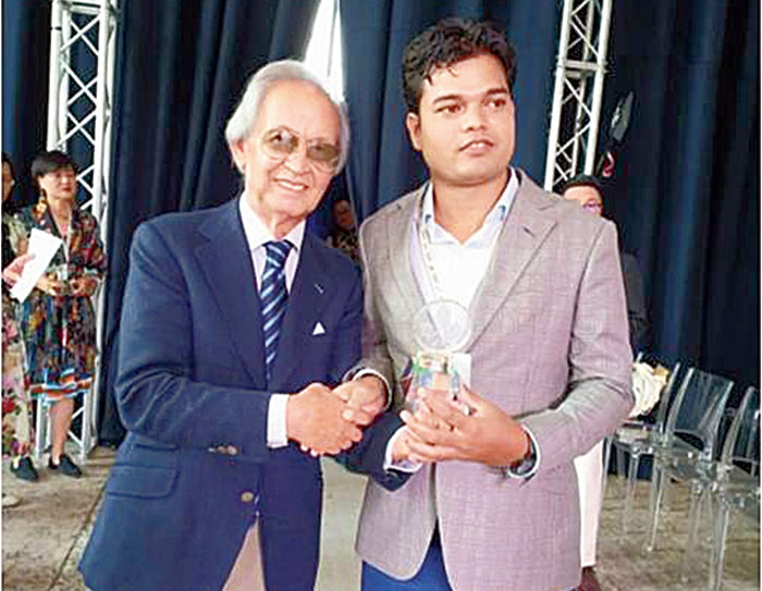 Moin Ansari receives his award at the 38th World Federation of Master  Tailors in Verona earlier  this month