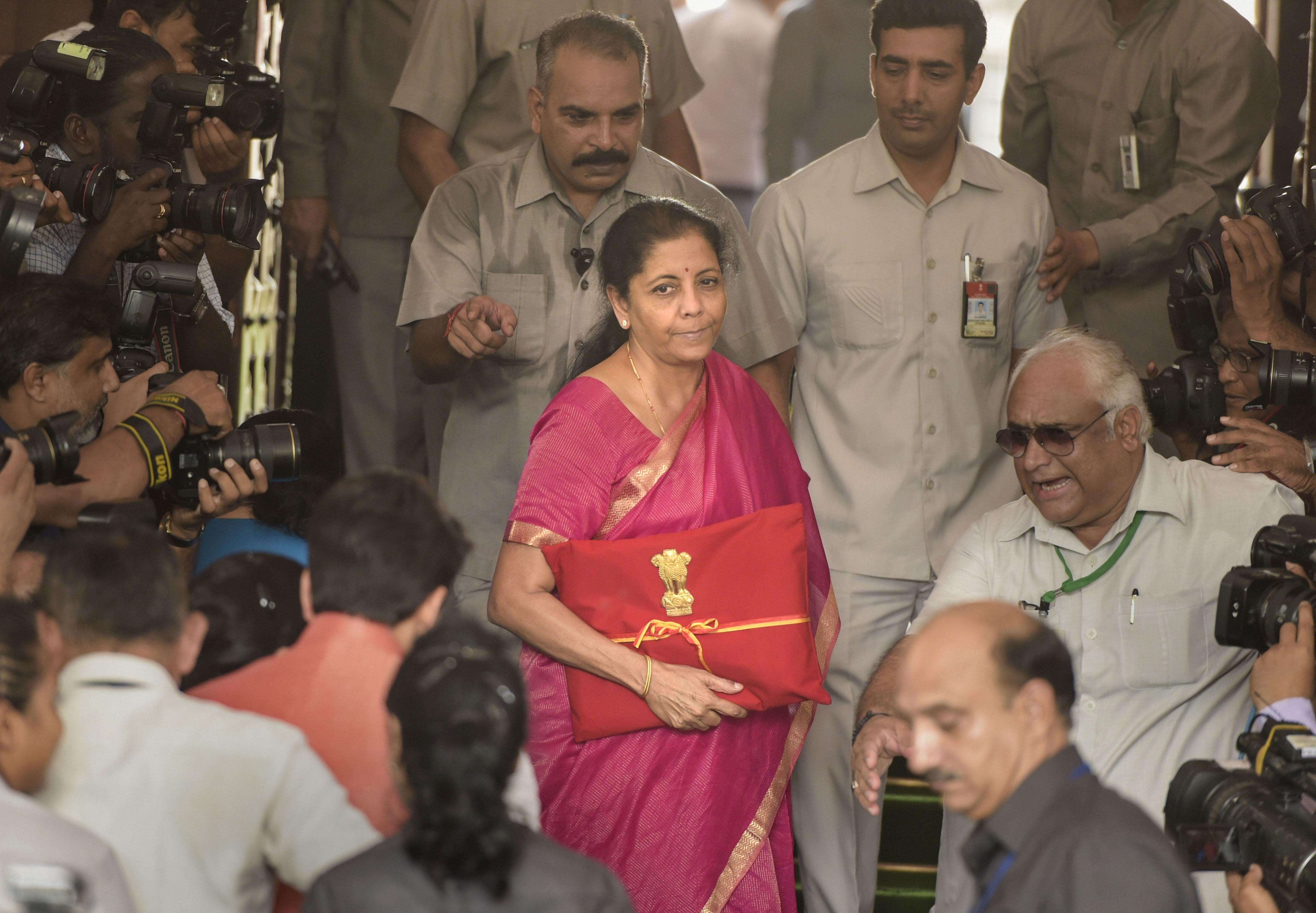 Sitharaman packs a punch in maiden budget but hits rich hard
