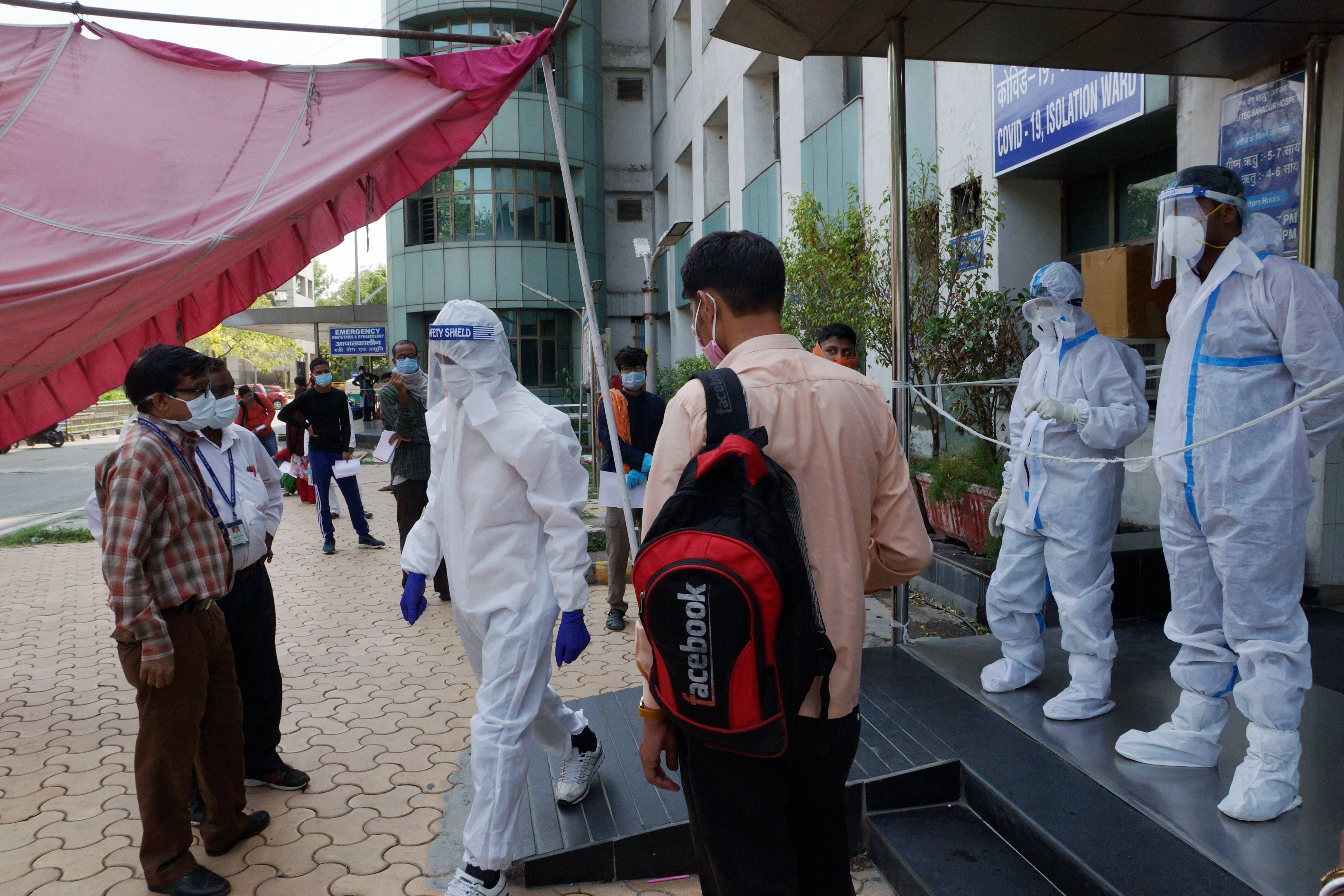 Suspected COVID-19 patients wait to be examined by medics at a government hospital, during the ongoing nationwide lockdown to curb the spread of coronavirus, in New Delhi on Tuesday, June 2, 2020.