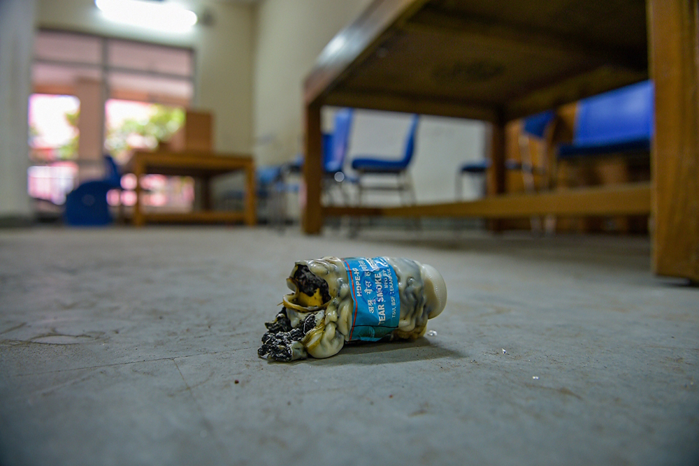 A tear gas shell lies on the floor of Dr Zakir Husain Library of Jamia Millia Islamia in New Delhi on Wednesday