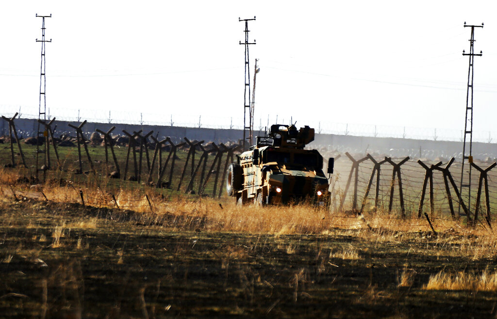 In this photo taken from the outskirts of the village of Alakamis, in Idil province, southeastern Turkey, a Turkish Army vehicles is driven in Turkey after conducting a joint patrol with Russian forces in Syria, Friday, November 8, 2019.