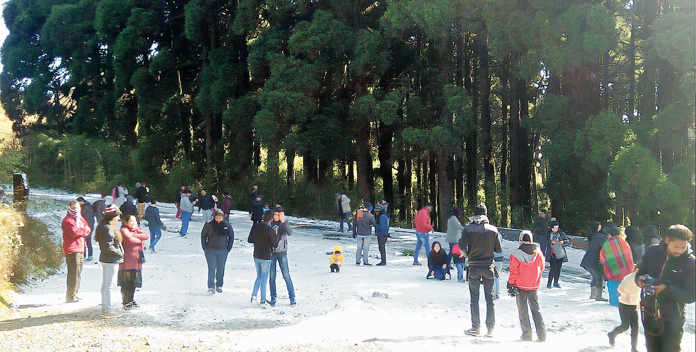 Snow lifts the mood at Tiger Hill near Darjeeling on Saturday.