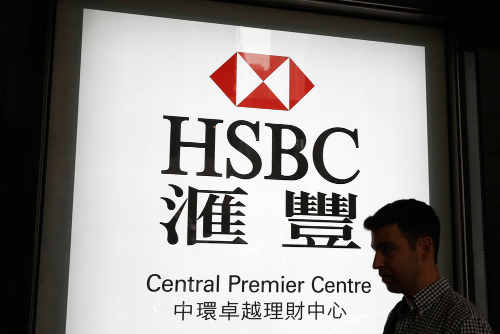 A man walks past a branch of HSBC bank in Hong Kong. London-based HSBC, whose profit is mainly from Asia, said it plans to revamp its US and European business
