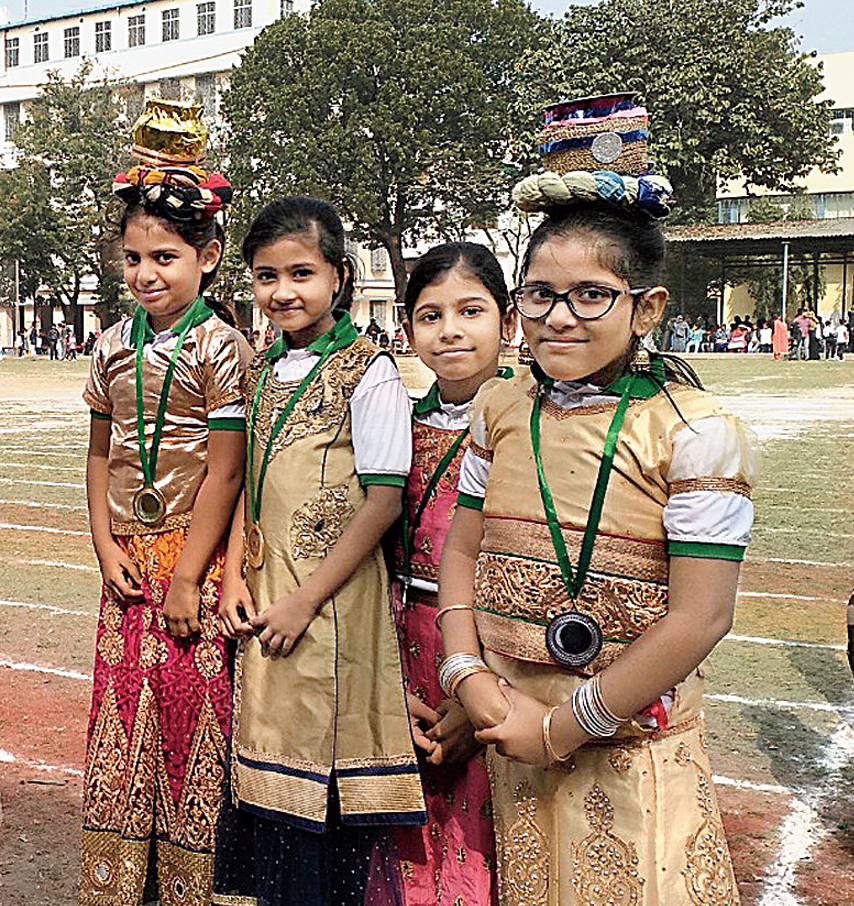 Kritika Roy (second from right) of Class III who lost her silver medal on the sports field on Wednesday