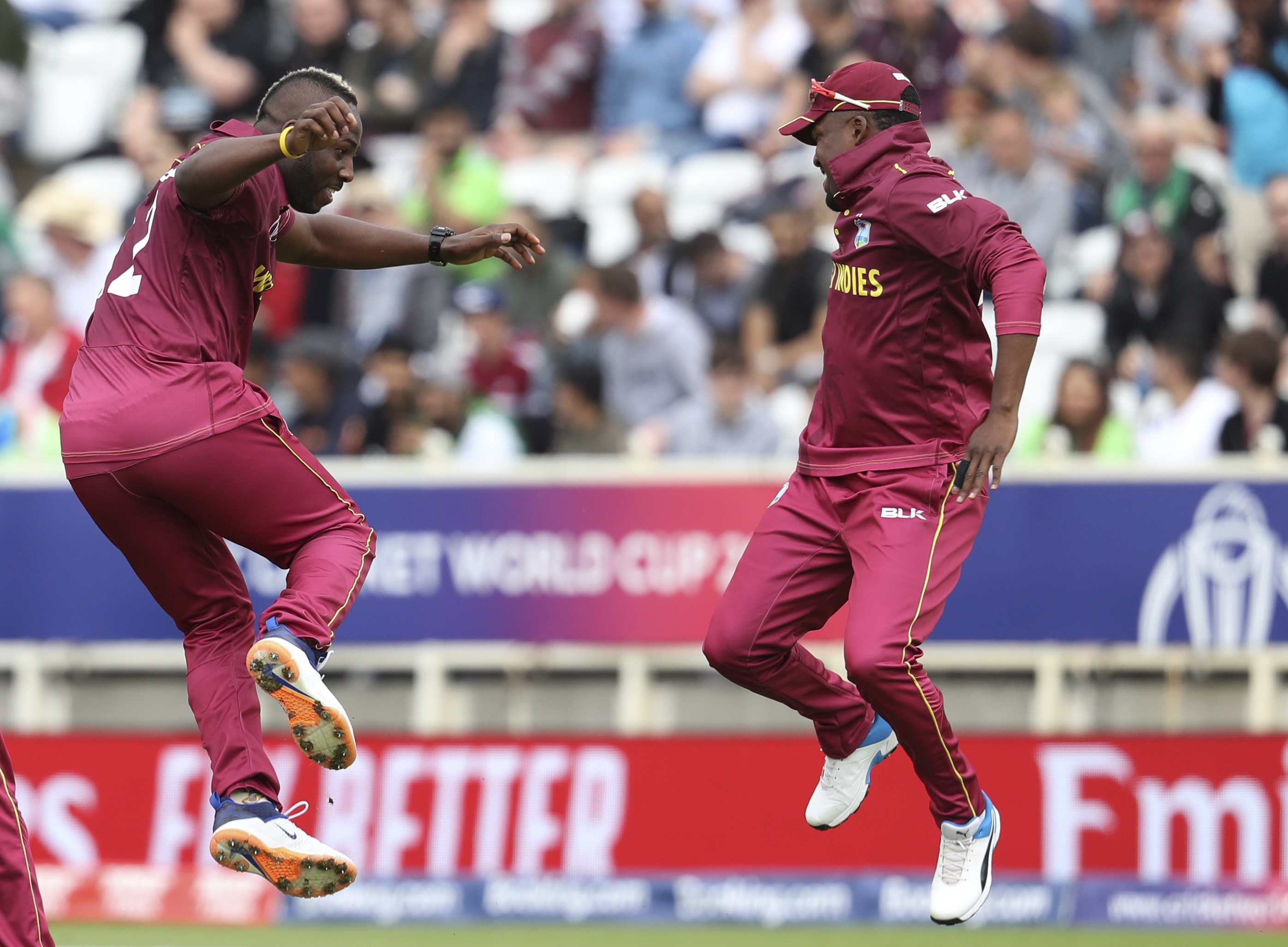 West Indies' bowler Andre Russell (left) celebrates with Darren Bravo taking the wicket of Pakistan's Haris Sohail at Trent Bridge on  May 31.
