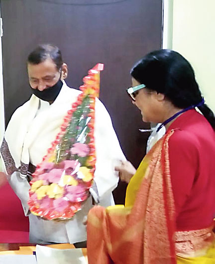 Kolhan University VC Gangadhar Panda is welcomed at the university office in Chaibasa on Thursday.