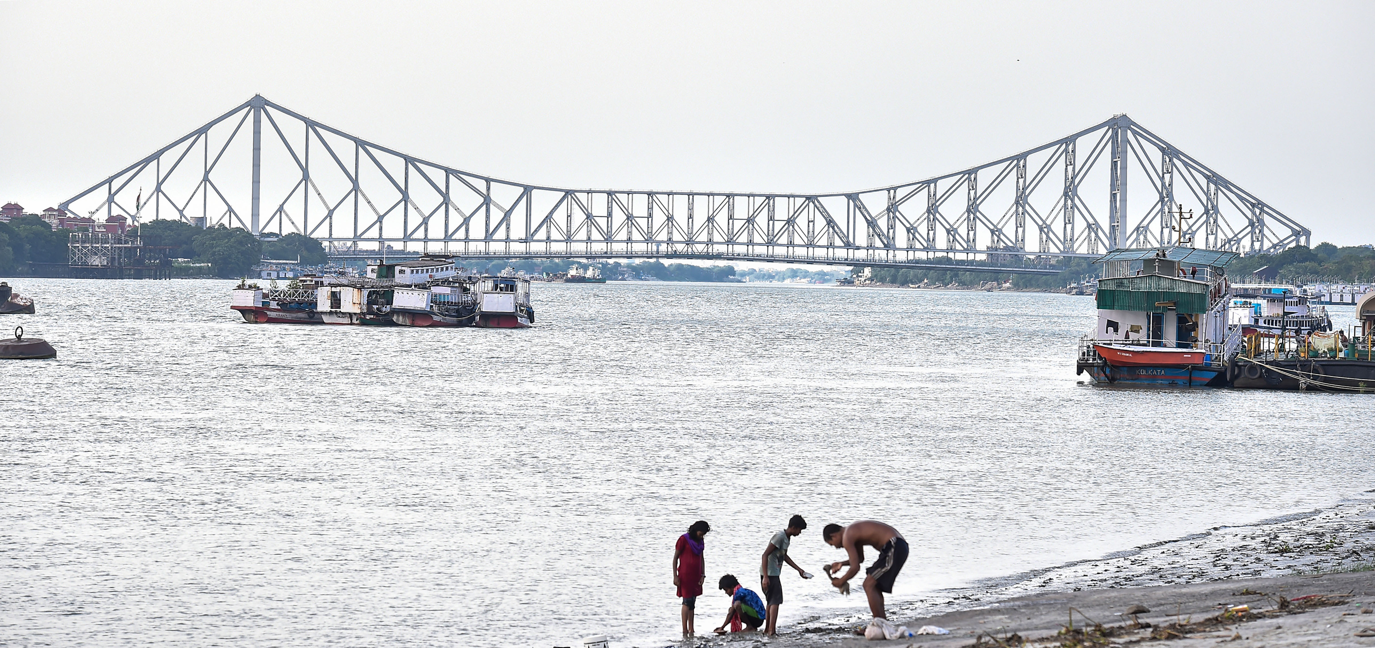 Boats remain anchored on river Ganga in the backdrop of Howrah Bridge during the ongoing nationwide lockdown to curb the spread of coronavirus in Calcutta, Saturday, May 16, 2020.
