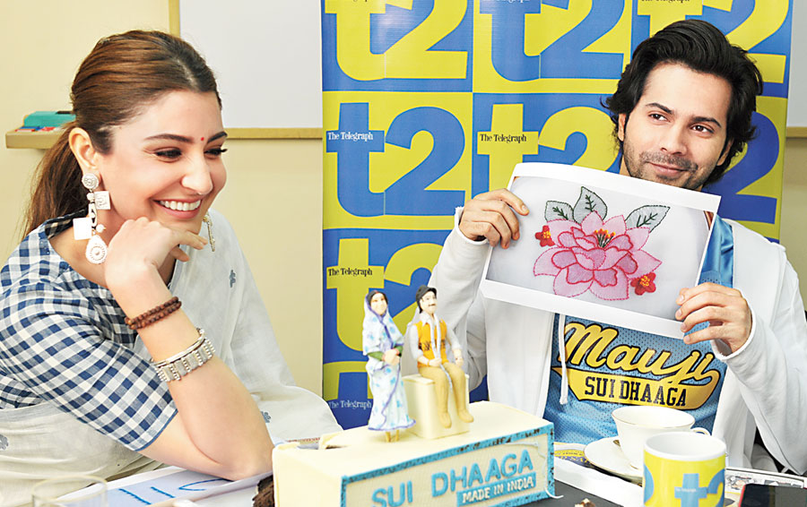 Varun Dhawan tries to guess the stitch type as Anushka Sharma looks on