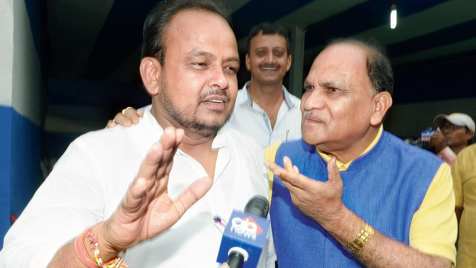 """BJP leader C.P. Singh (right) asks Congress MLA Irfan Ansari to chant 'Jai Shri Ram' on July 24, 2019. A letter protesting the imposition of the slogan was portrayed in a subsequent letter as """"a disguised attempt to pour disdain on the subalterns for whom faith and worship are defining dimensions"""""""