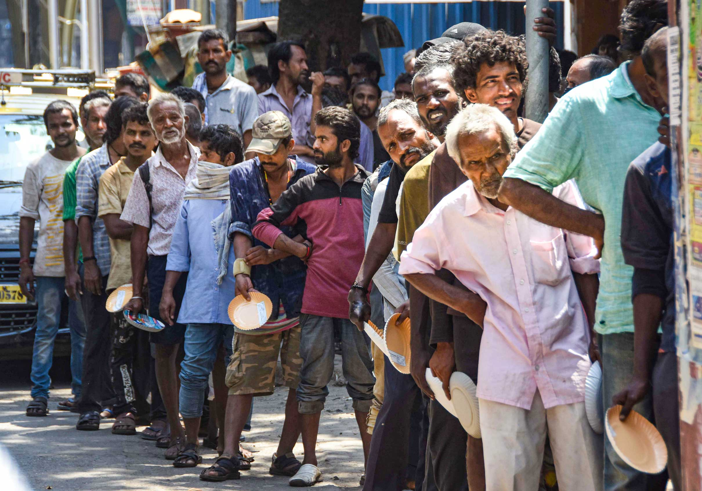 Volunteers of an NGO distribute food to the needy during the coronavirus lockdown in Mumbai on Tuesday. The FAO has put out a list of questions and answers related to the impact of Covid-19 on food availability and disruption in the supply chain.
