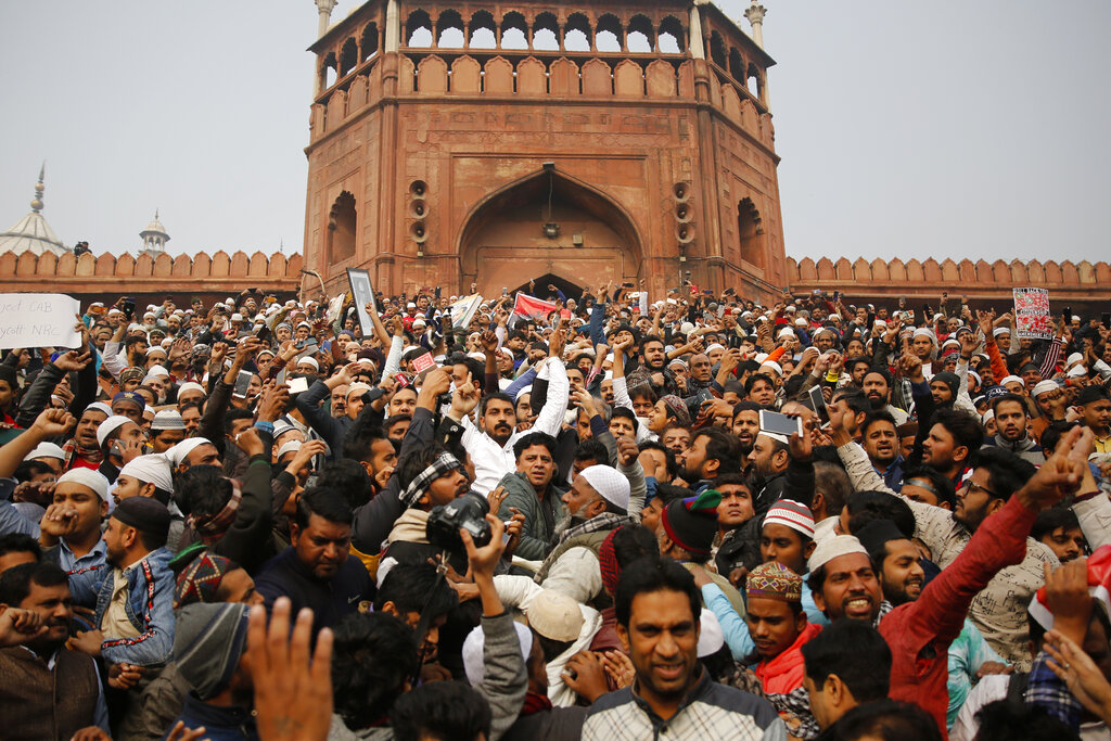 Dalit leader and Bhim Army founder Chandrashekhar Azad, center in white, joins others for a protest against the Citizenship Amendment Act after Friday prayers outside Jama Masjid in New Delhi, Friday, December 20, 2019.