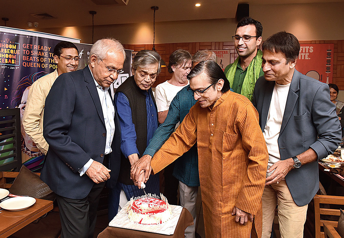 Team Shanku cuts a cake at Barbeque Nation
