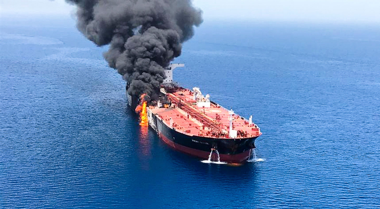 Fire and smoke rising from a tanker that was attacked in the Gulf of Oman on June 13, 2019.