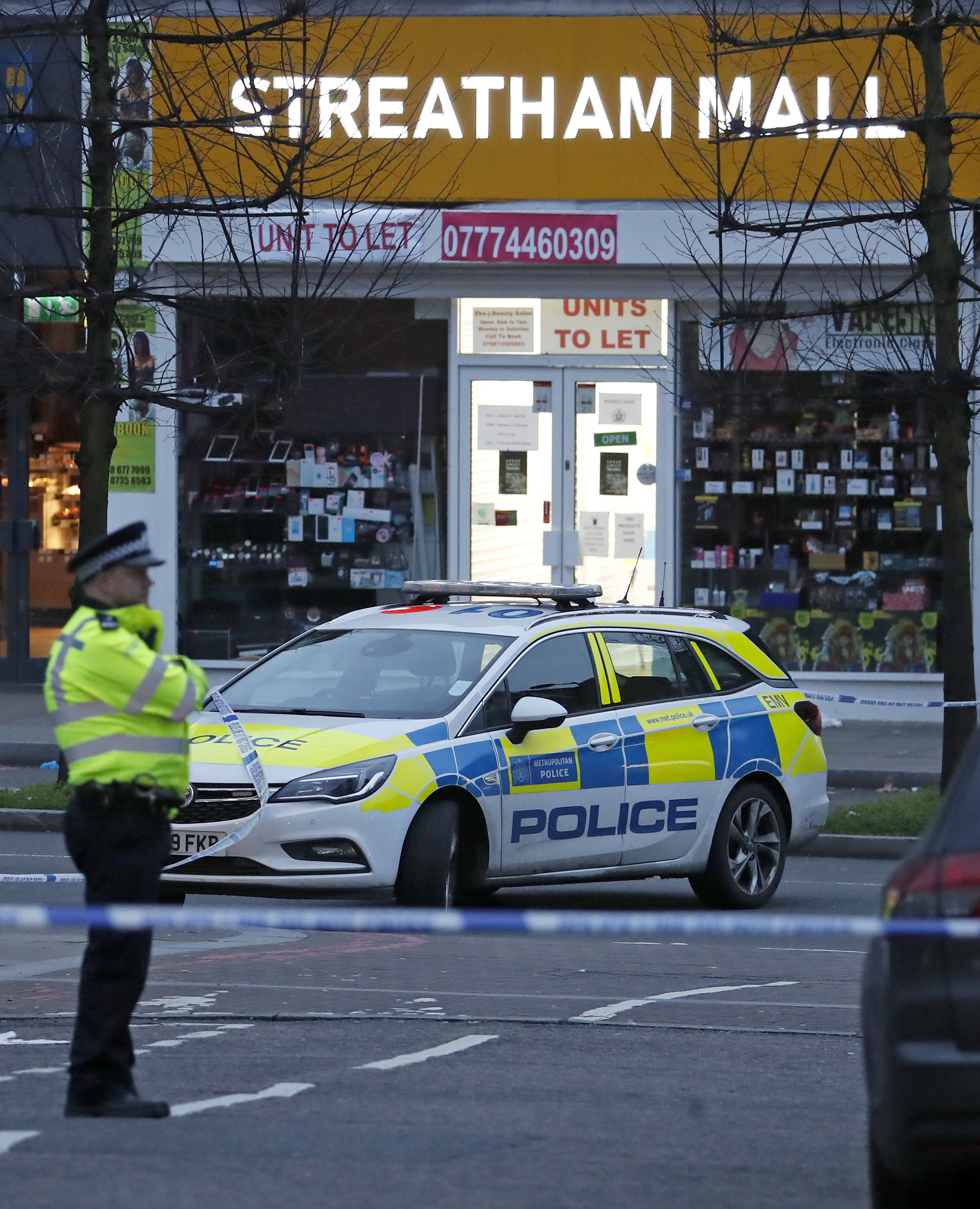 Police secure the area in Streatham London, England,  after a stabbing incident.