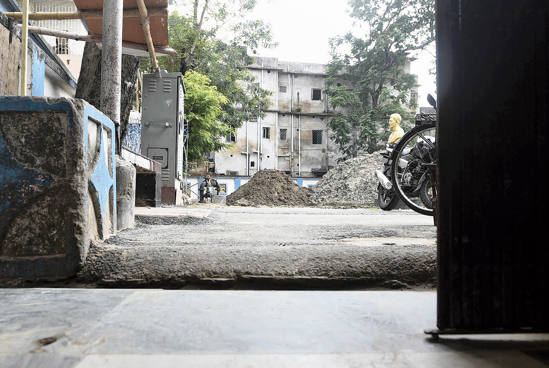 The view from the inside of a house in Dhakuria shows the level of the road is much higher than the house because of additional layers of bitumen