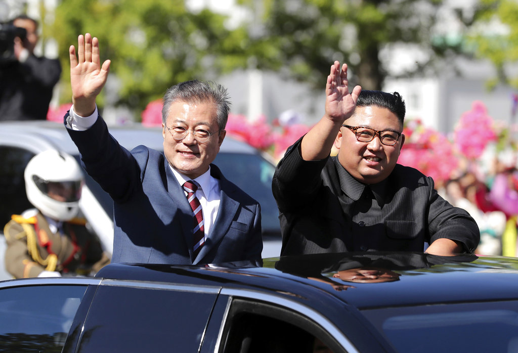 In this September 18, 2018, file photo, South Korean President Moon Jae-in (left) and North Korean leader Kim Jong-un during a parade through a street in Pyongyang, North Korea.