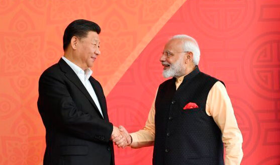 Xi Jinping and Narendra Modi shake hands in Mamallapuram. Xi stressed the need for greater engagement on defence and security. He invited the defence minister to China.