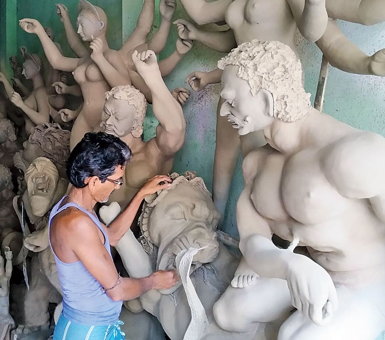 A clay artisan in East Burdwan's Nadanghat sculpts idols, but does not know if they would find buyers.