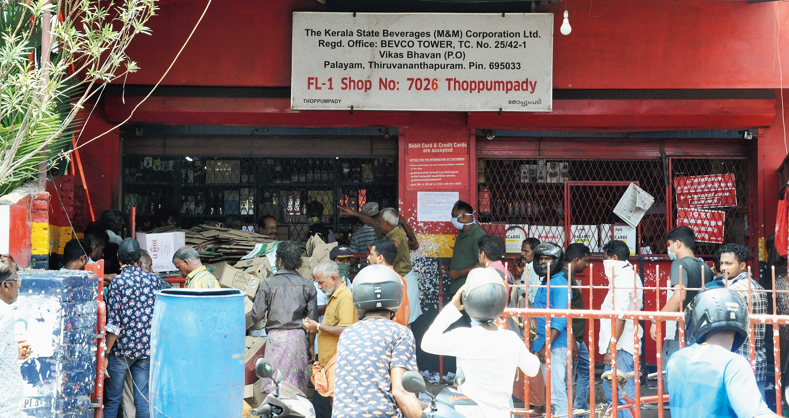Customers at the beverages corporation outlet in Thoppumpady, Ernakulam, on Monday.