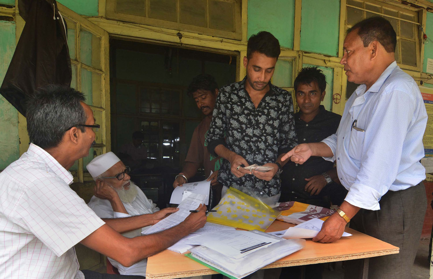 People undergo a verification process for the National Register of Citizens in Guwahati, Assam, on Wednesday, June 26, 2019. The normalization of mob violence against minorities can only be a preliminary to the the real substance of a Hindu rashtra, namely the legitimization of formal discrimination