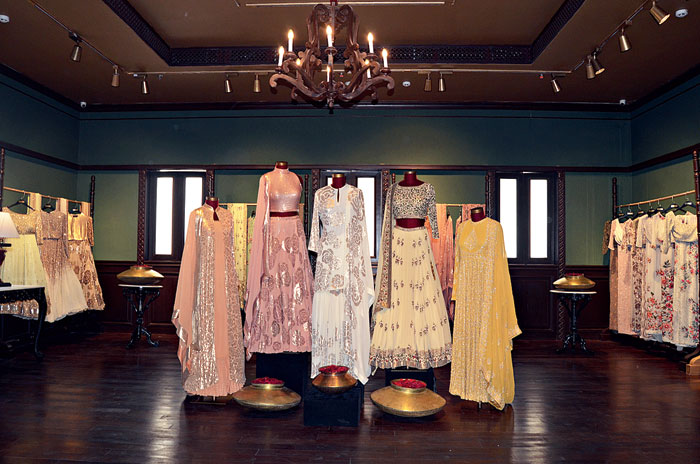 The display is divided into two broad categories of light and heavily embroidered ensembles. From traditional saris and lehngas to shararas and kurtas, the collection caters to all kinds of formal occasions. For a touch of the contemporary, there is a range of cockatil saris and capes too.