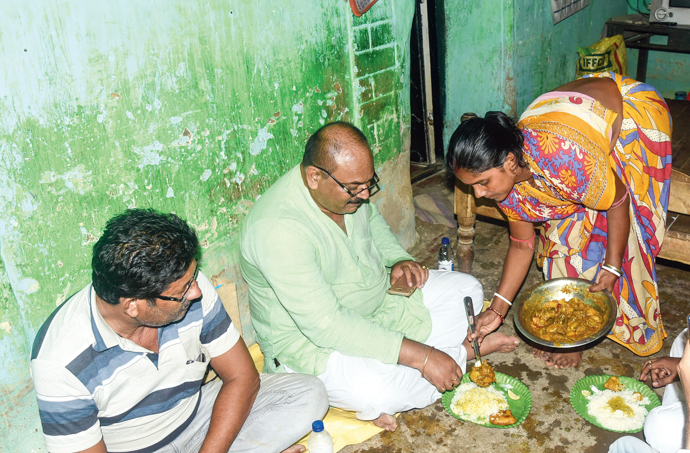Sinha is served dinner at a Trinamul worker's home in Birbhum's Baruipur village.