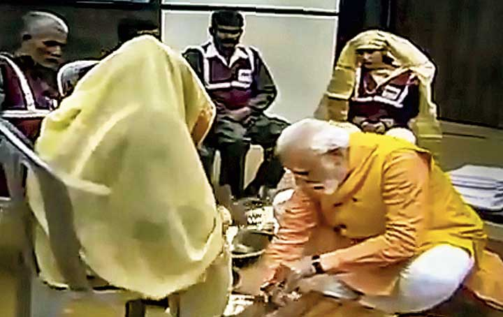 Footage shows Narendra Modi honouring the sanitation workers in Allahabad on Sunday.