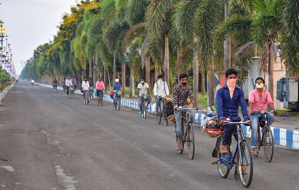 Migrants ride on bicycles to their native places, during the ongoing Covid-19 nationwide lockdown, in Calcutta Wednesday, May 6, 2020.