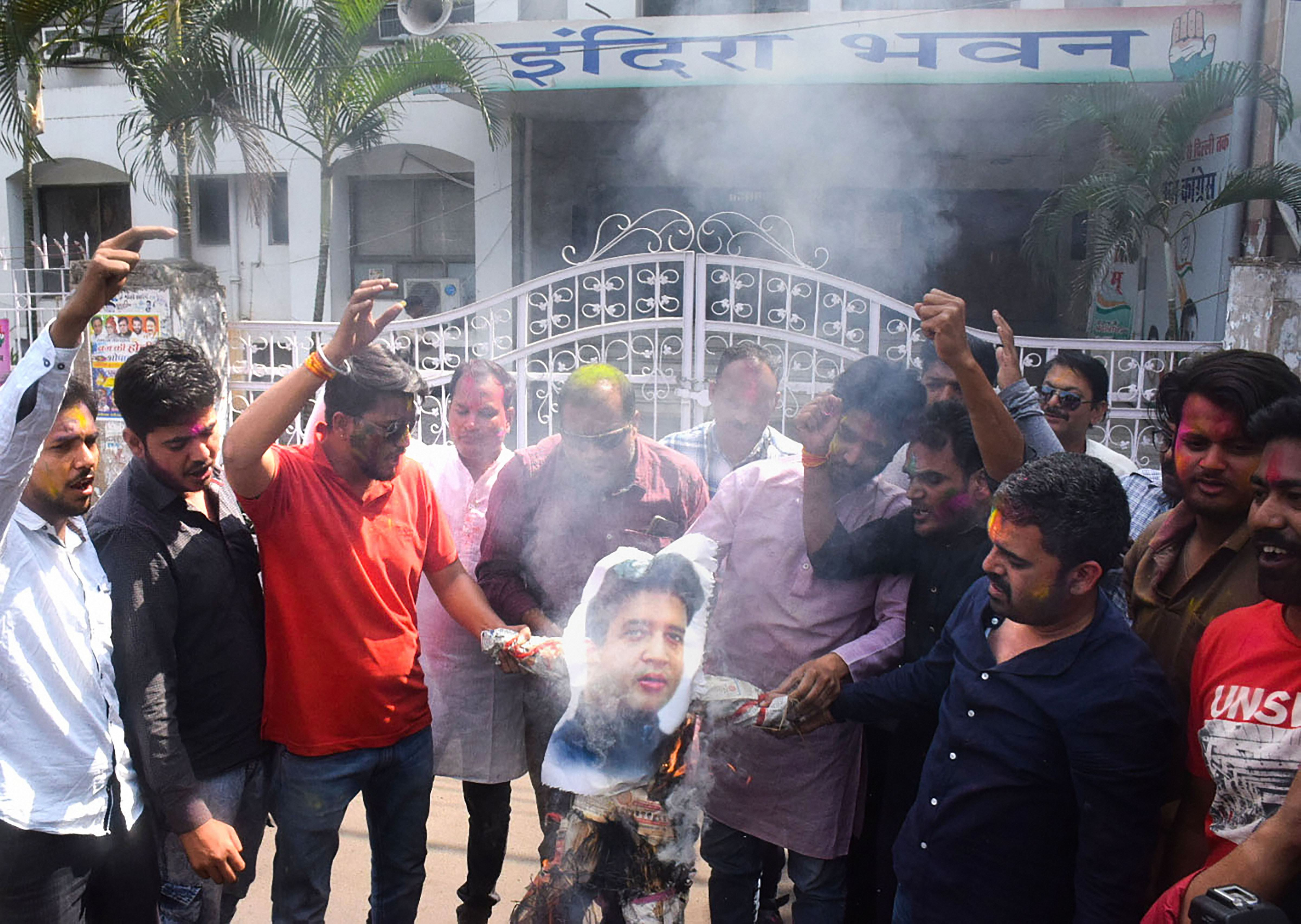 Congress party activists burn an effigy of Jyotiraditya Scindia after he resigned from the party, at PCC headquarters in Bhopal, Tuesday, March 10, 2020