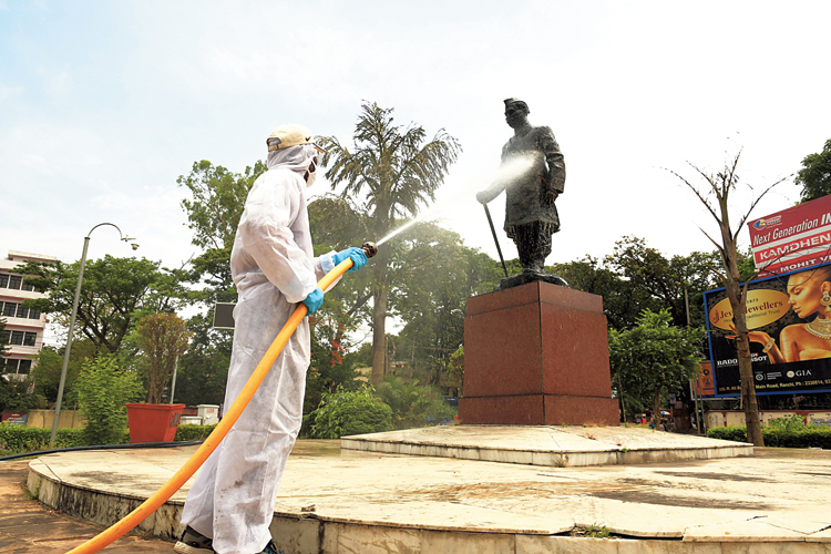 SANITISED STATUE: A civic worker sprays disinfectant at the statue of India's first President Dr Rajendra Prasad in Ranchi on Monday.