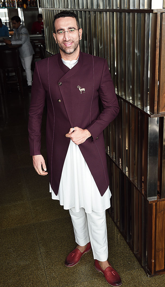 """This look was sealed in flat five minutes! """"It was confirmed that I would be wearing this,"""" laughed Sudhir. """"His height… and also because he has a strong presence,"""" said Ratul who gave Sudhir an Indo-western ensemble — an Anarkali kurta with piping and a new cut teamed with pure silk jacket. """"Great for an Indian-themed party,"""" said Ratul."""