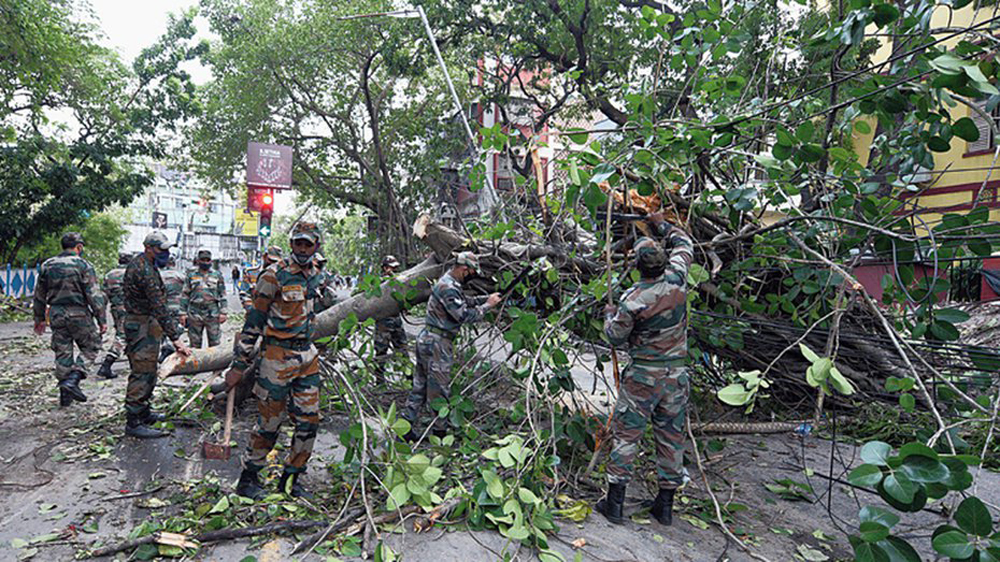 Army personnel cutting and removing trees on Ballygunge Circular Road in Calcutta on May 23