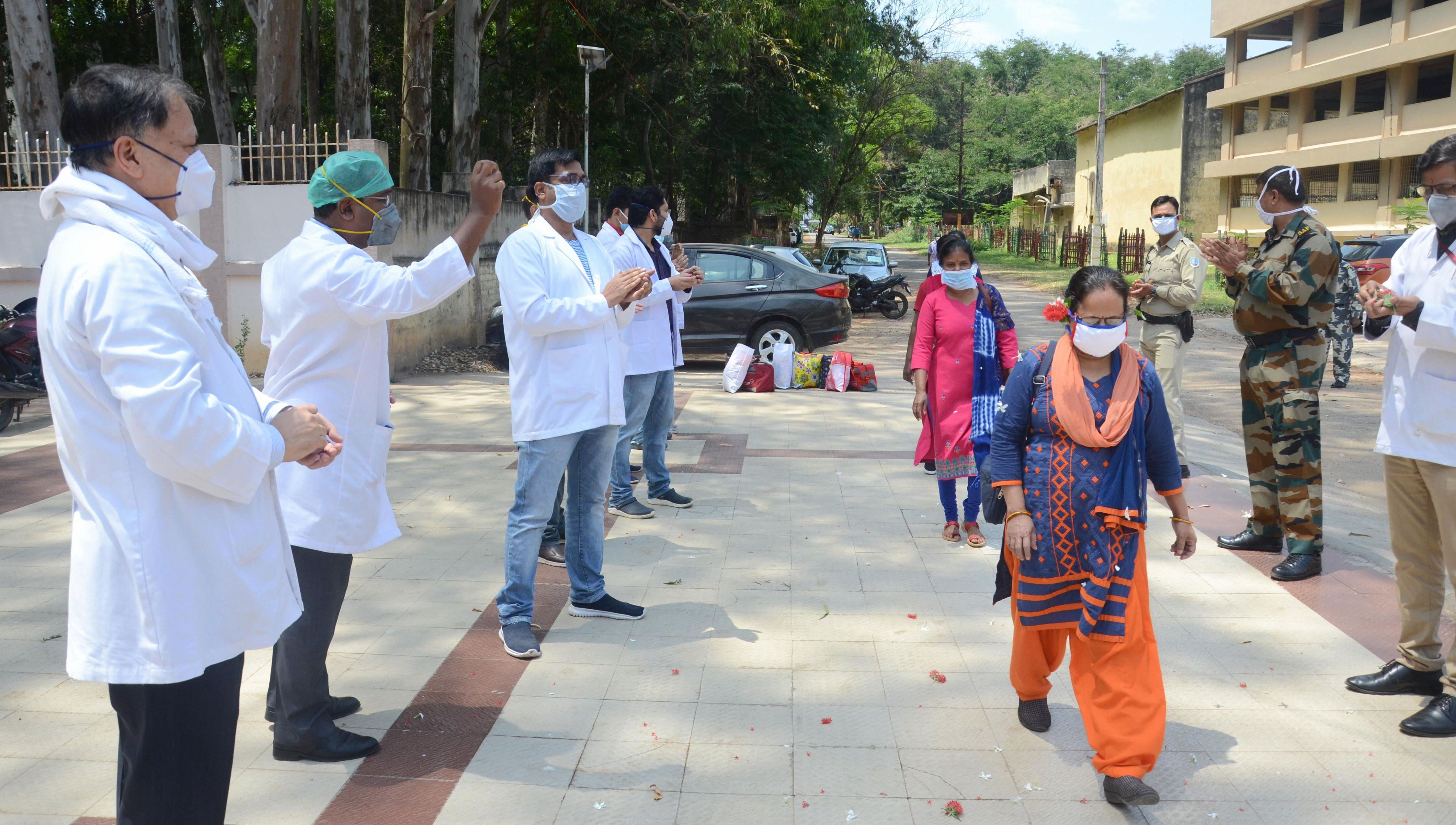 Senior doctors of Rajendra Institute of Medical Sciences (RIMS) applaud for junior doctors who completed their quarantine period, during a nationwide lockdown in the wake of coronavirus pandemic, at Hindpiri area in Ranchi, Wednesday, April 22, 2020.