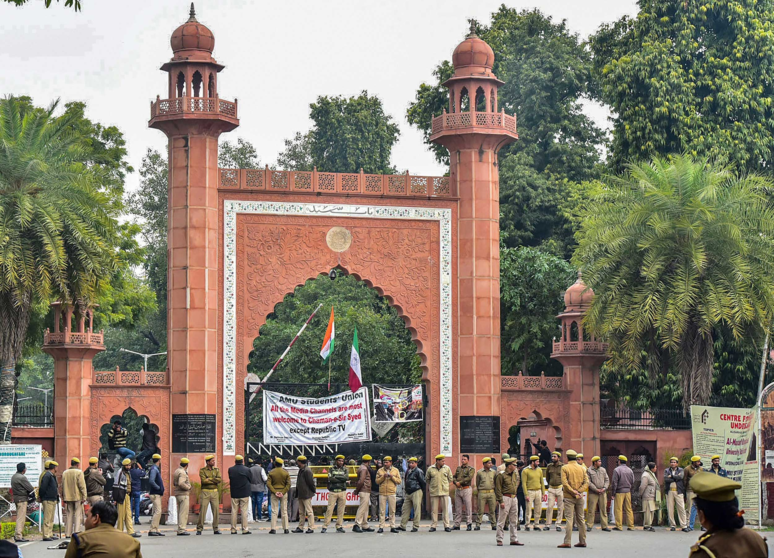Police deployed on the campus of Aligarh Muslim University in the view of protests after students were booked on alleged sedition charges, in Aligarh, on Friday.