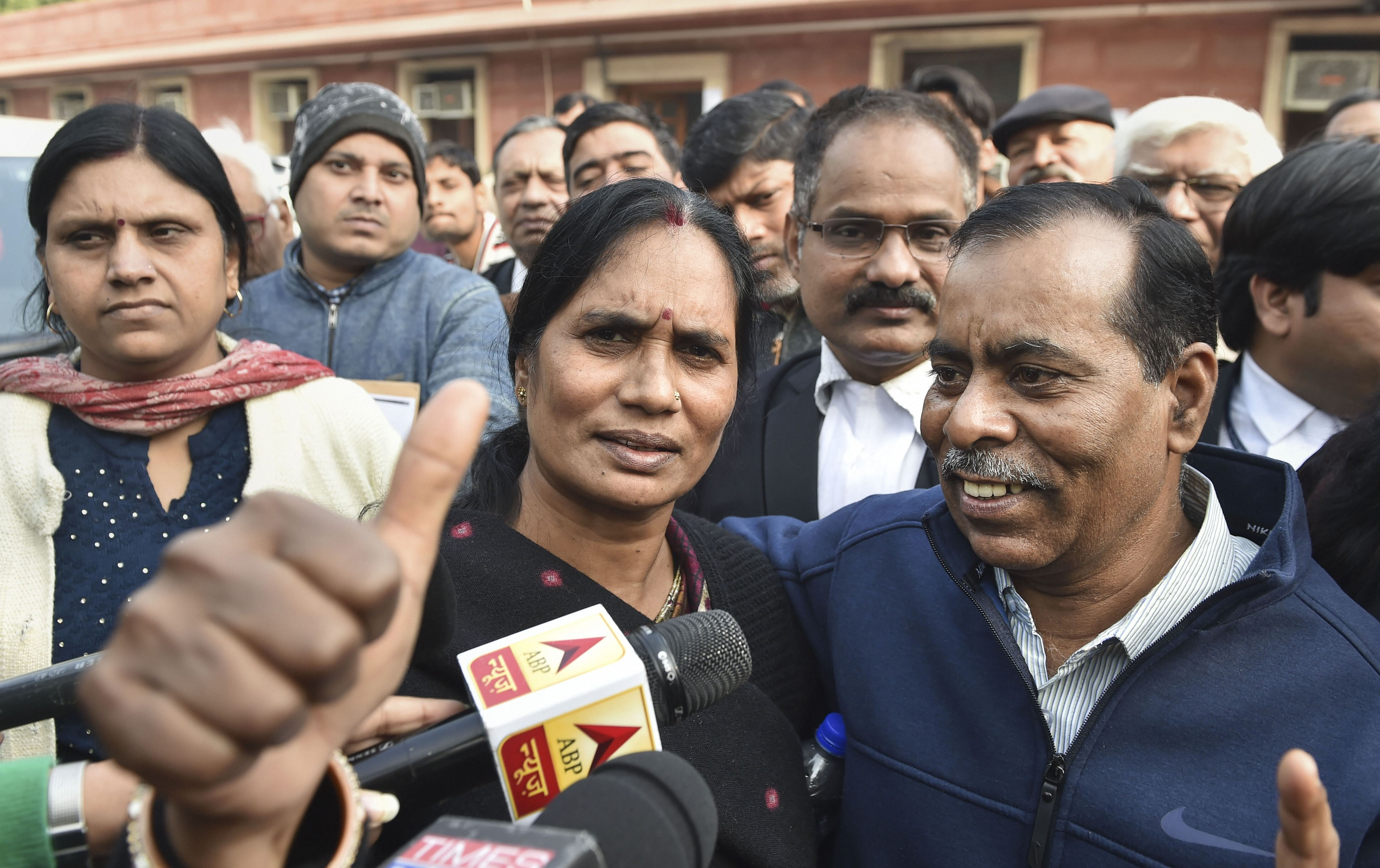 Nirbhaya rape case victim's parents after a hearing at the Supreme Court, in New Delhi, Wednesday, December 18, 2019.
