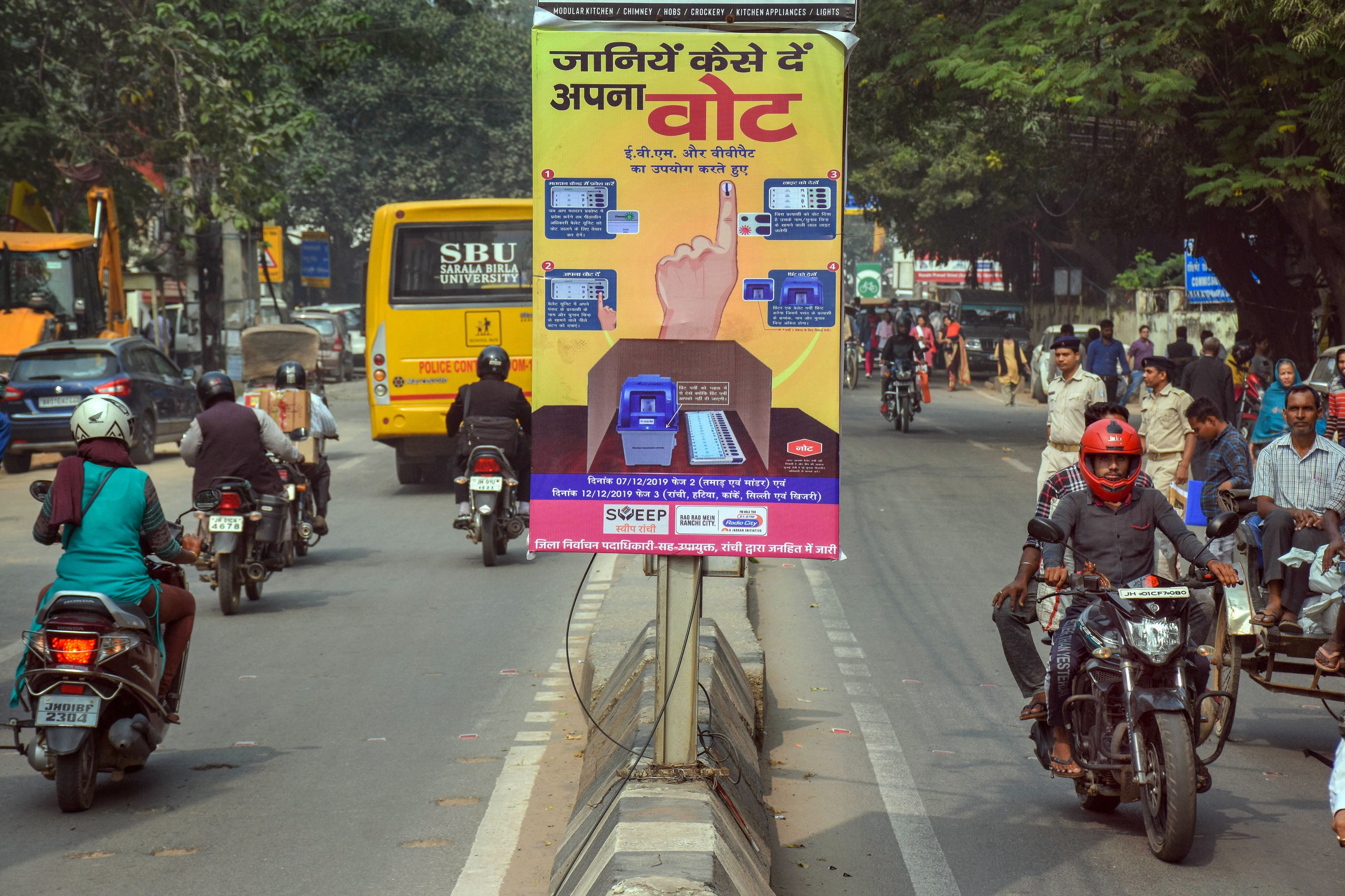 A pole banner put up by the Election Commission educates voters on how to vote, ahead of the Jharkhand Assembly polls, in Ranchi, Tuesday, November 5, 2019.