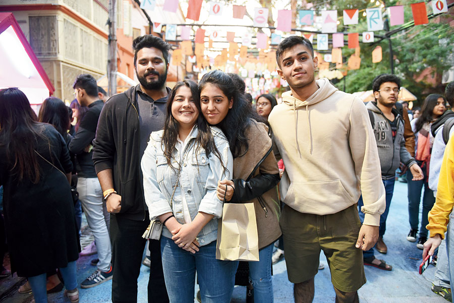 "(L-R) Adityesh Jaiswal, Priyanka Arora, Anya Doshi and Aditya Singh Roy dropped in as a group. ""It's the most beautiful time of the year, seeing an entire lane on the streets of Calcutta get so creative, being lit and painted so beautifully,"" said Priyanka, the owner of Nick N Nack."