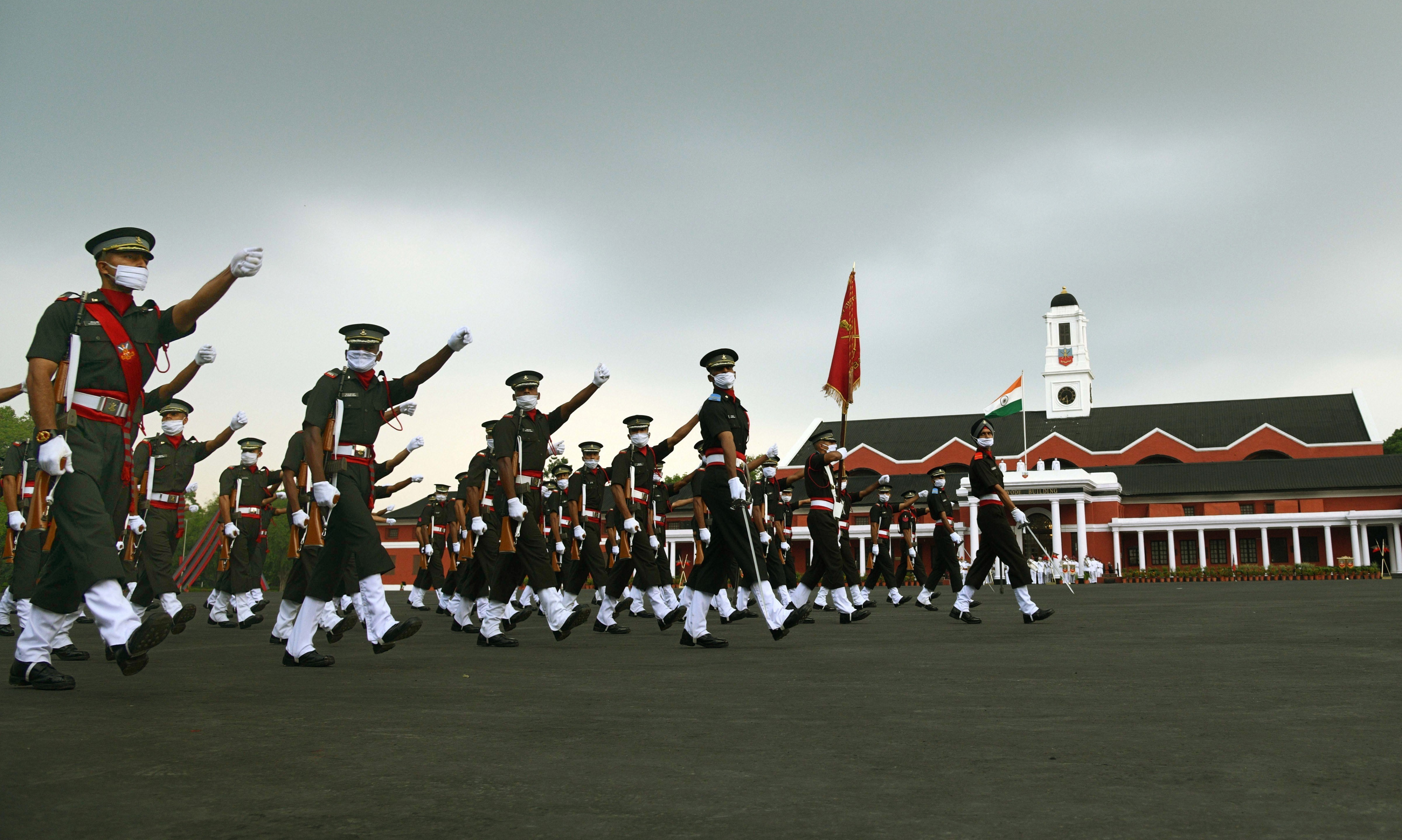 Newly-inducted officers march during the passing out parade at Indian Military Academic (IMA) in Dehradun on Saturday.