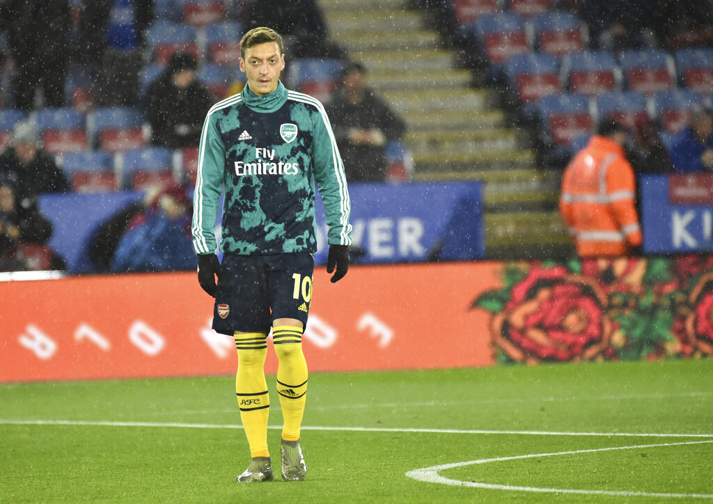 In this file photo dated Saturday, November 9, 2019, Arsenal's Mesut Ozil warms up prior to the the English Premier League soccer match against Leicester City at the King Power Stadium in Leicester, England