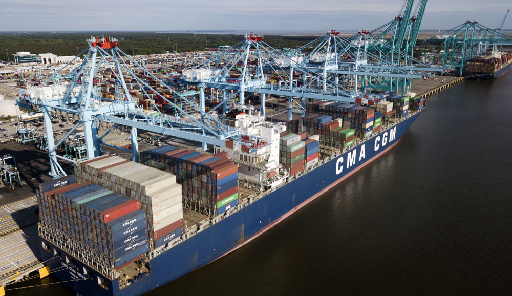 In this May 9, 2019, file photo a container ship is unloaded at the Virginia International Gateway terminal in Norfolk, Virginia.